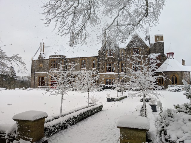 Huntsham Court in the winter with snow
