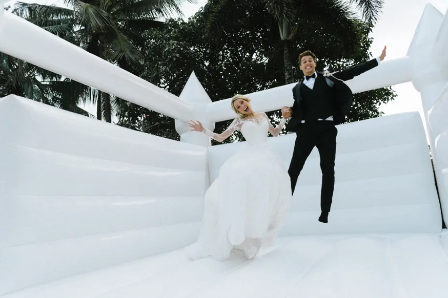 wedding day bouncey castle - photo from Huff post