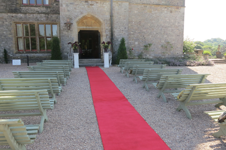 Huntsham Court - outdoor ceremony - west terrace - red carpet
